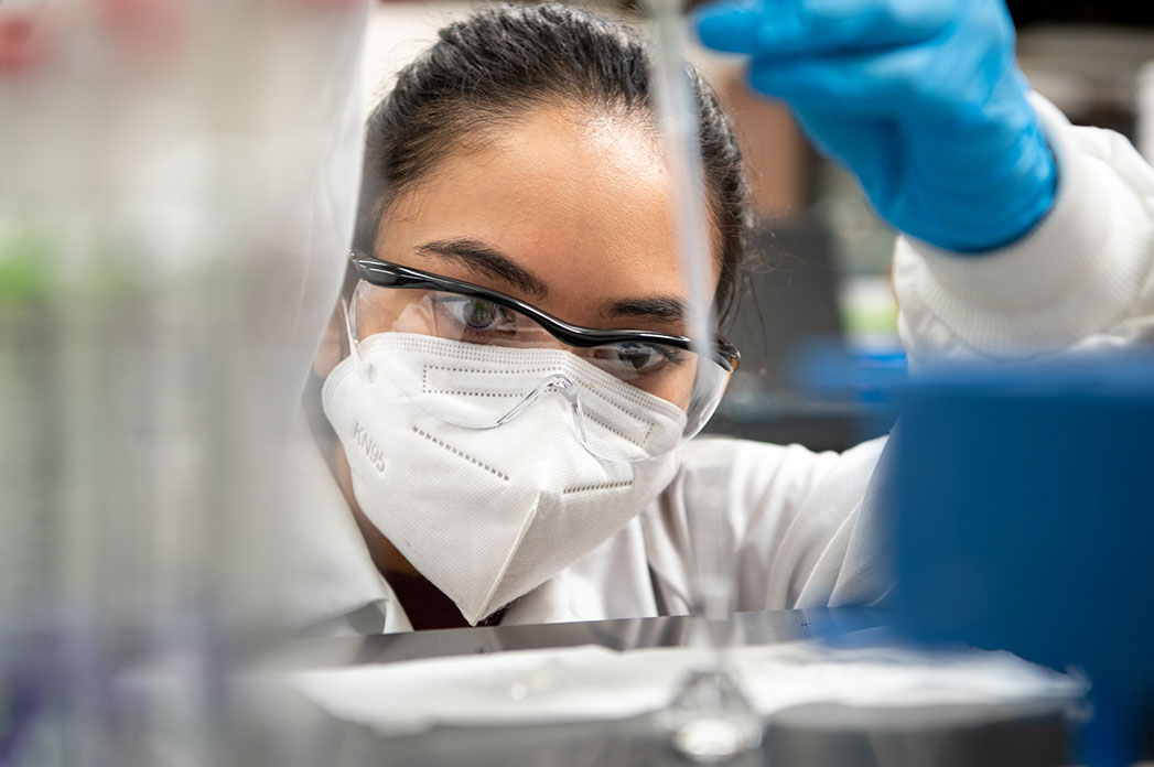 close up of female scientist in protective gear