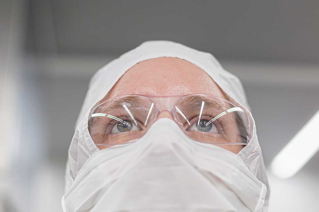close up of scientist in protective gear
